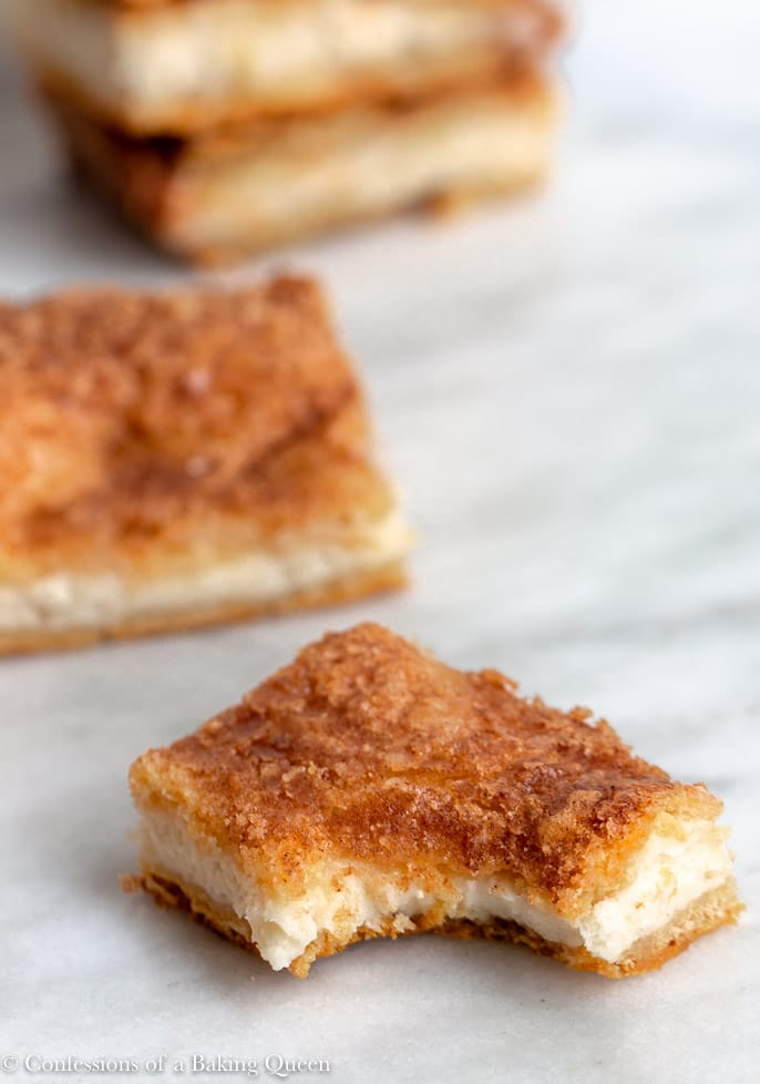 sopapilla bars being eaten on a white marble