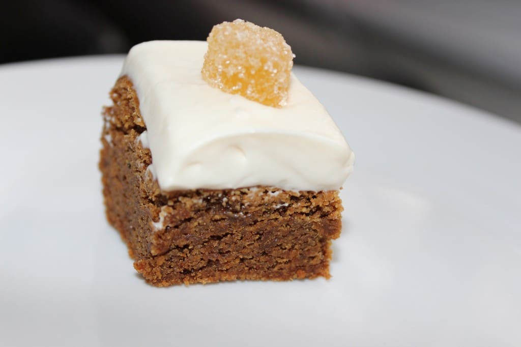 Gingerbread Brownies w/ Cream Cheese Frosting on a white plate