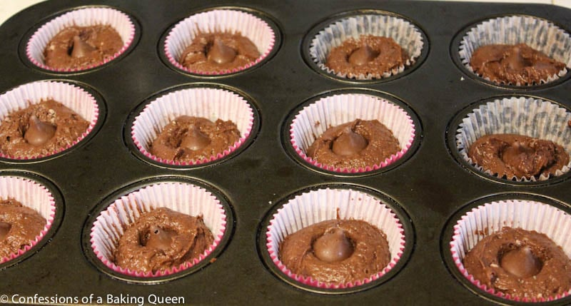 Chocolate cupcakes batter in the muffin tin before baking