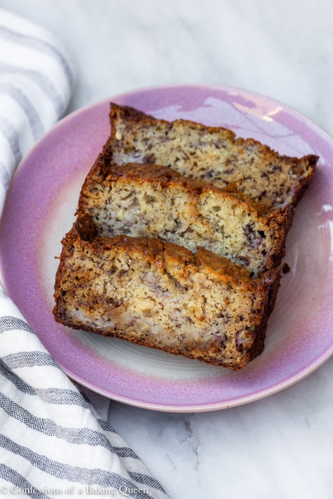 baked salted caramel banana bread slices on a pink plate