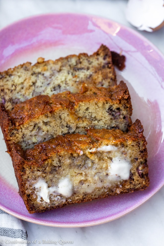 baked salted caramel banana bread with butter melting on a piece on a pink plate