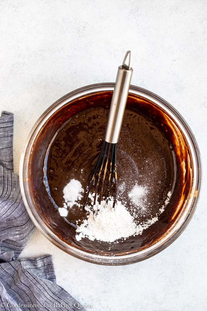 baking soda, salt, and cornstarch added to brownie batter in a glass bowl