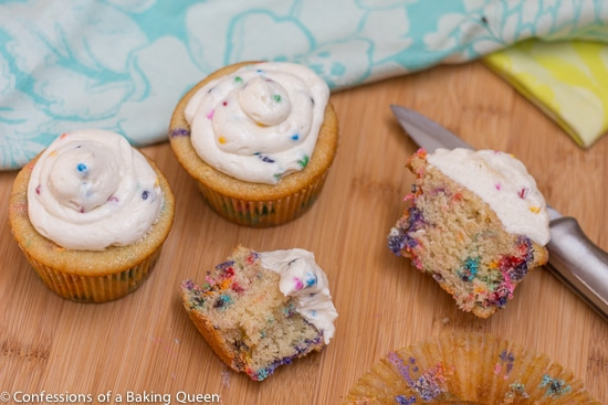 Homemade Rainbow Chip Cupcake pieces on a wood board