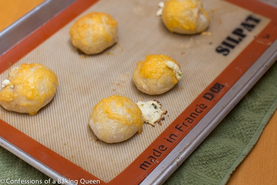 Bagel Bombs hot out of the oven on a silpat lined baking sheet