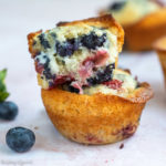 strawberry blueberry muffin broke in half sitting on top of each other