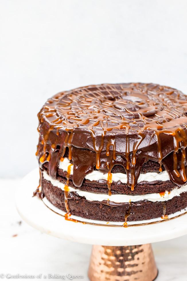 Salted Caramel Chocolate Cake Recipe showing top of cake caramel swirls on a white background