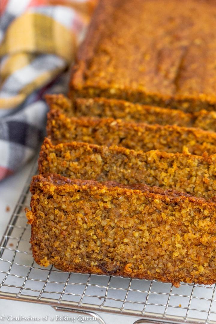 oat flour pumpkin bread sliced on a wire rack