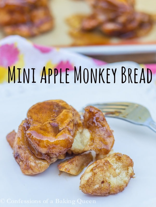 Mini Apple Monkey Bread cut up on a white plate with the rest in the background