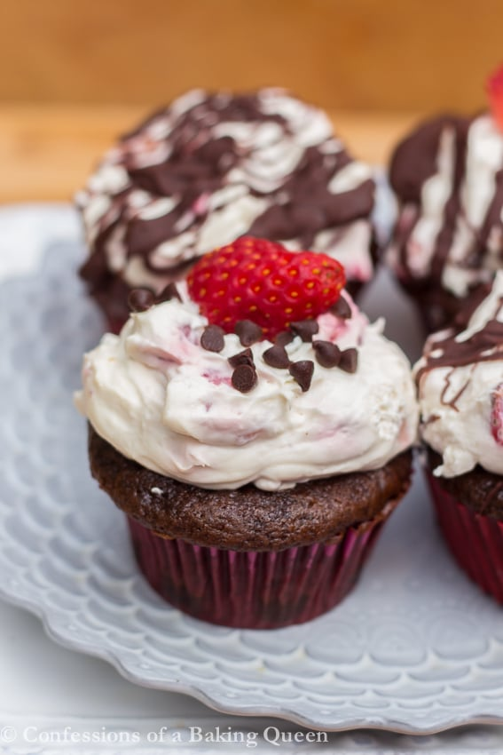 up close of Strawberry Chocolate Cupcakes on a purple plate