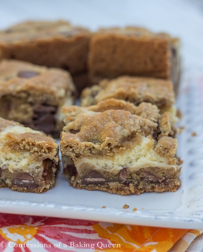 Cookie Butter Chocolate Chip Cheesecake Bars on a plate