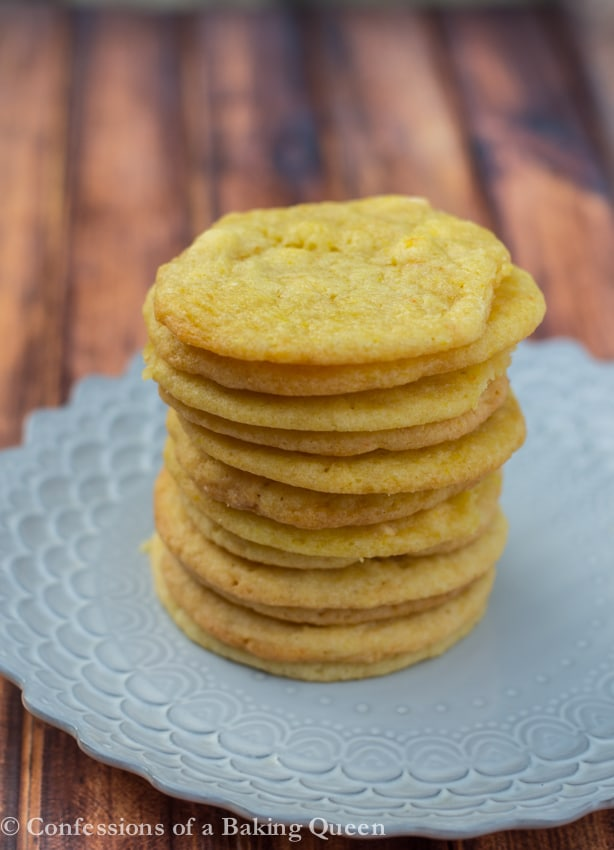 Chewy Lemon Cookies stacked on a purple plate