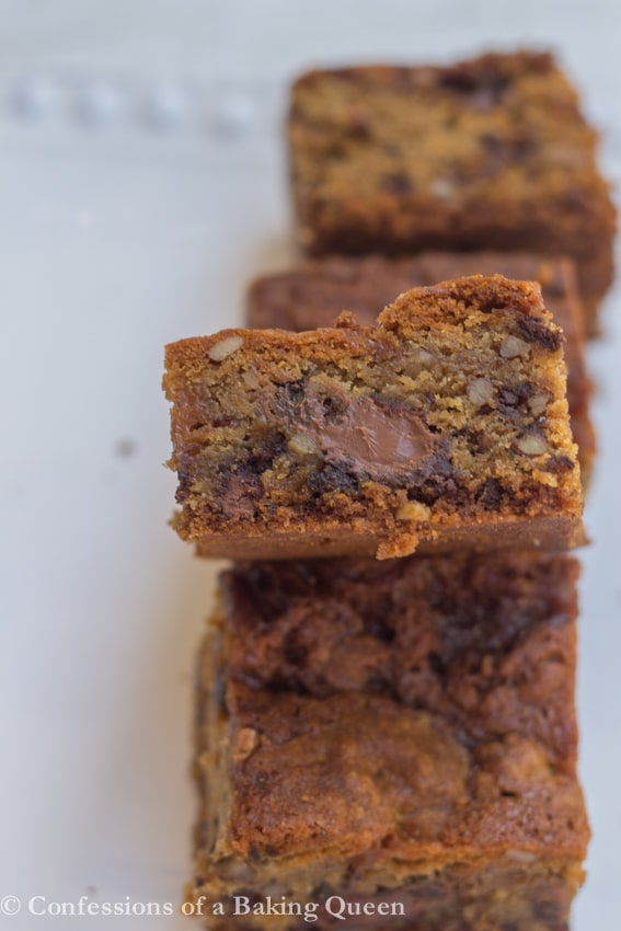 Salted Caramel Pecan Chocolate Chip Blondies side shot with gooey chocolate