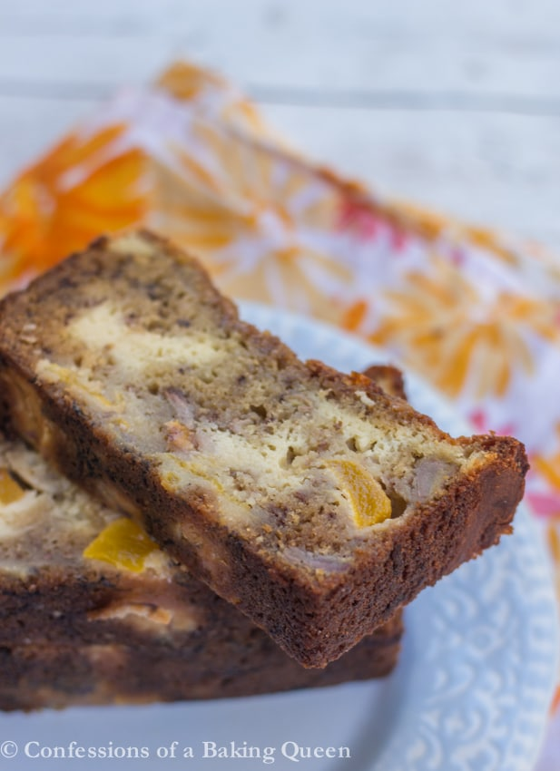 Peaches & Cream Banana Bread slices stacked on top of each other on a blue plate