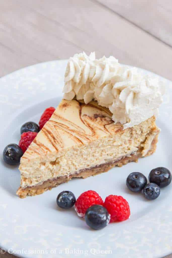 Cinnamon Roll Cheesecake with berries on a blue plate