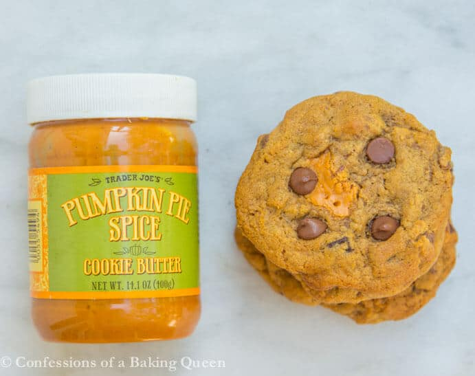 Pumpkin Chocolate Chip Cookie Butter Cookies next to a pumpkin pie spice cookie butter jar on white marble