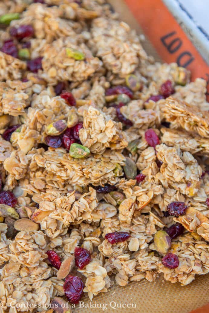 Christmas Granola just baked and ruffled up on a silpat lined baking sheet