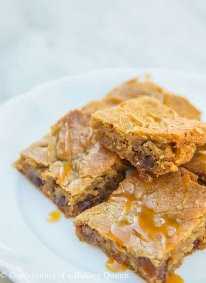 Sticky Toffee Pudding Blondies stacked on a white plate