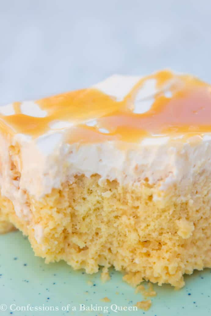 salted caramel tres leches cake on a blue plate
