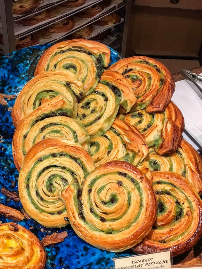 paris eats pastry snails on a blue plate