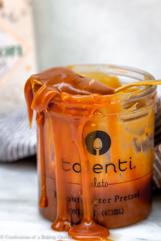homemade salted caramel sauce in a container oozing out