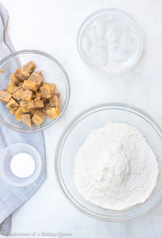 ingredients laid out for brown butter pie crust on a marble surface