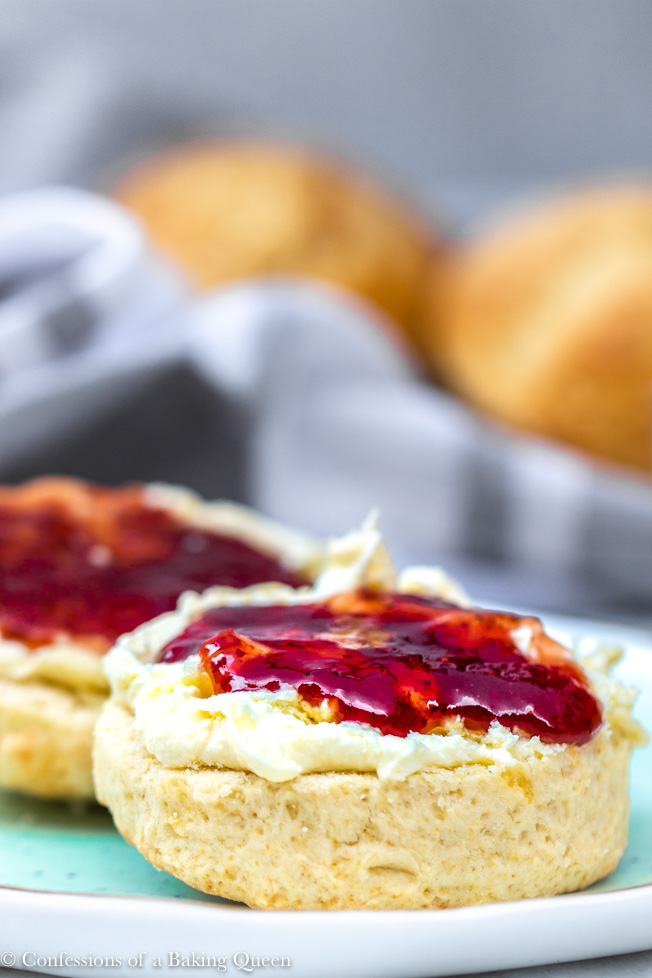 close up of scone with clotted cream and preserves