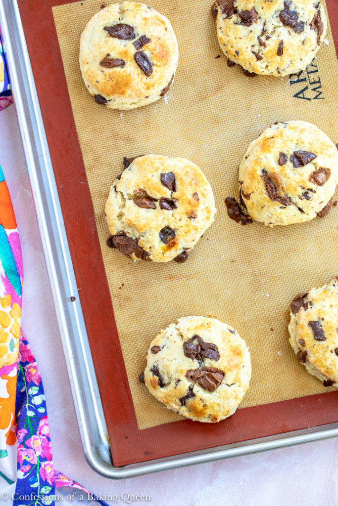chocolate chunk scones baked on a silpat lined baking sheet