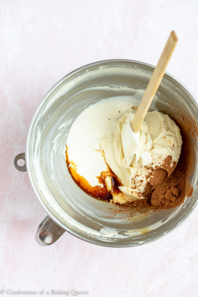 vanilla extract, heavy cream and cocoa powder added to cream cheese for a chocolate cheesecake batter