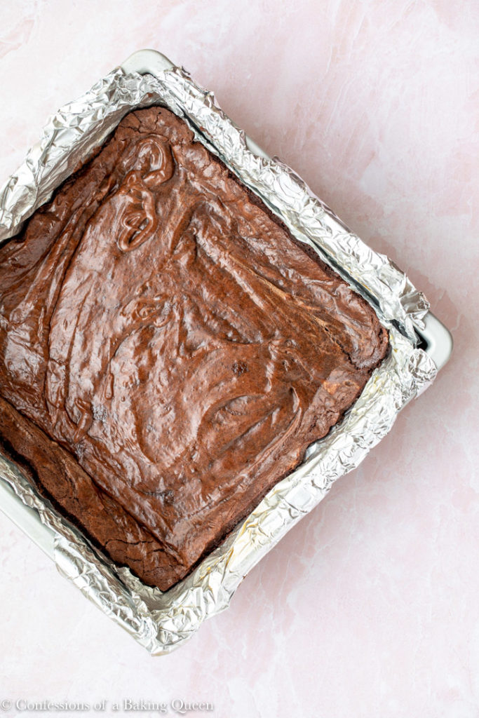 brownies just set before cheesecake batter for a chocolate brownie cheesecake batter