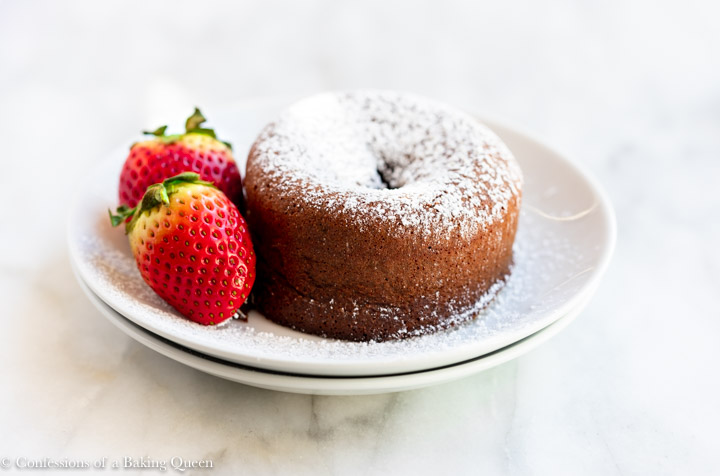 chocolate lava cake on a white plate with berries