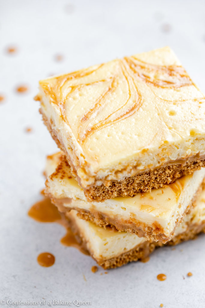 overhead view of three cheesecake bars stacked on top of each other