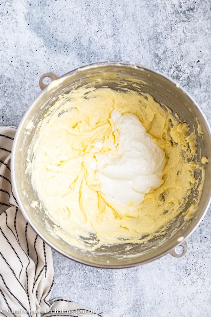sour cream added to wet ingredients in a large mixing bowl